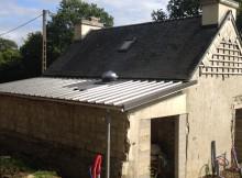 conduit de lumière installé dans une extension bois - toiture zinc